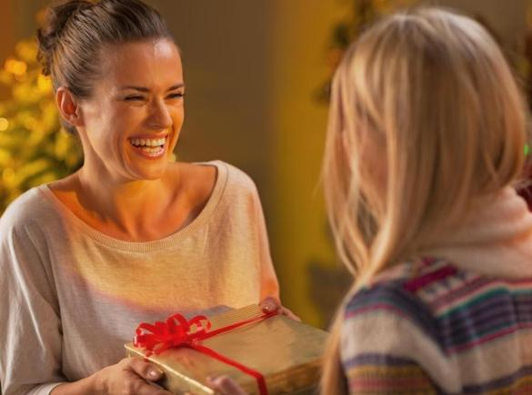 laughign-woman-holding-present-near-other-woman